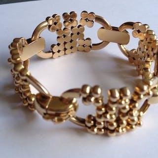 18K Bracelet or jaune composé de 4 motifs avec boules articulées