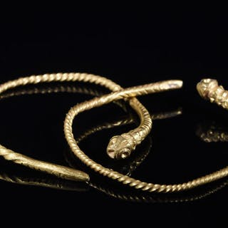 Prehistoric, Bronze Age Gold Pair of Twisted Snake-shaped Earrings