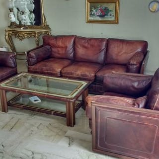 Set of sofas and two leather armchairs, along with the center table