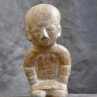 Image / FLUTE i.d.v.v. a squat seated figure. (1) - Earthenware - Ecuador