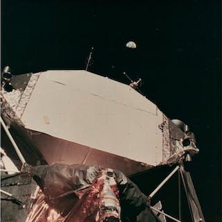 NASA- AS11-40-5924 - Earth above rear side of Lunar Module, Apollo 11, 1969