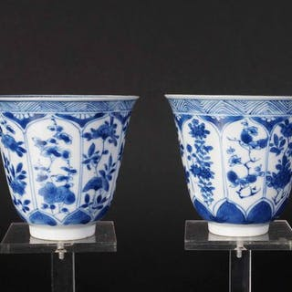 Set of blue and white high model cups with floral decor...