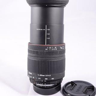 Sigma 28-300mmmanual digital y analogicoparasol y tapas(Montura Nikon )