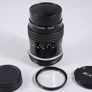 Nikon Micro 55mm 2.8 con filtro y tapas