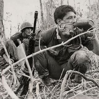 Horst Faas (1933-2012)/Associated Press - Soldier drinks from plastic canteen
