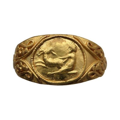 Ancient Roman Gold ring with god Pan mounting a goat