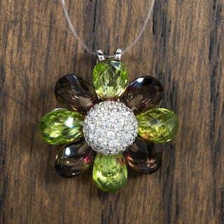 18 kt. Gold - 4.50 carat - flower/sun shaped tourmaline and diamond pendant.