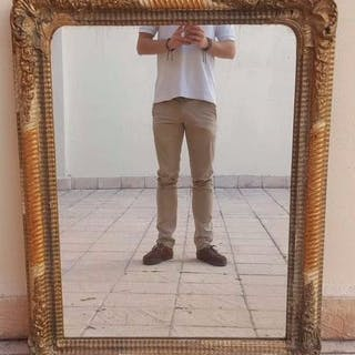 Mirror, Mirror 'Elizabethan' in carved and gilded wood. XIX century.