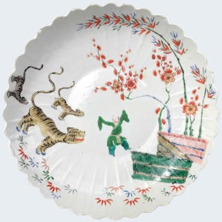 Large famille verte dish decorated with a boy and a tiger...