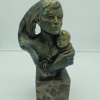 Statuetta/e