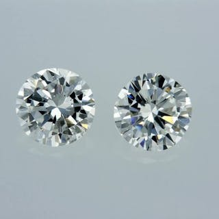 2 pcs Diamonds - 0.87 ct - Round - E - VS1