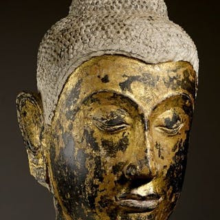 Head - Sandstone partially gilded with gold over black...