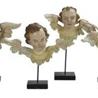 Four Carved and Polychrome Wooden Winged Angel Heads