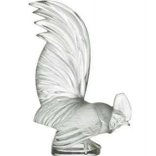 René Lalique (1860-1945), a clear and frosted glass paper-weight 'Coq
