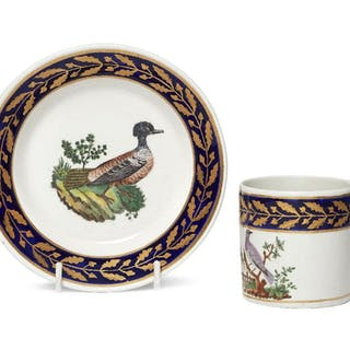 An English cabinet cup and saucer, 19th century, the rim of cup and