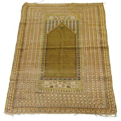A Prayer rug, early 20th century, with ochre coloured prayer panel