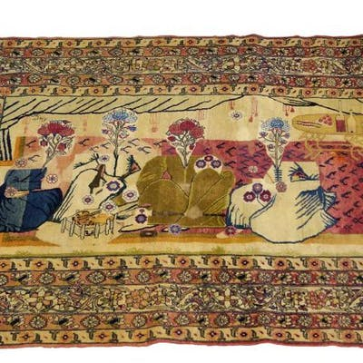 A Kirman pictorial rug, early 20th century, the field with four stylised
