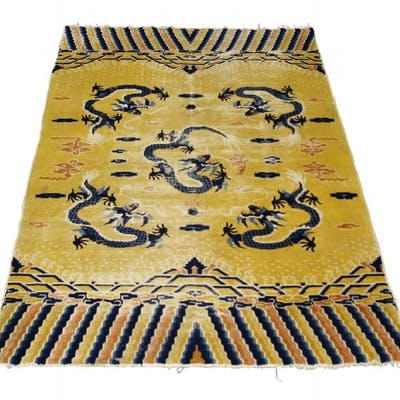 A Chinese rug, early 20th century, the golden yellow field with five