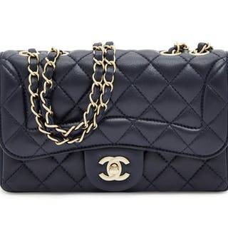 a588a889c0e841 Chanel: a small Classic Flap navy blue lambskin shoulder bag, the