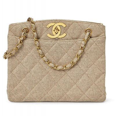 Chanel: a quilted buff coloured fabric bag, with two internal zippered