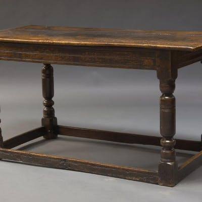 An oak refectory table, early to mid 18th Century, the three plank