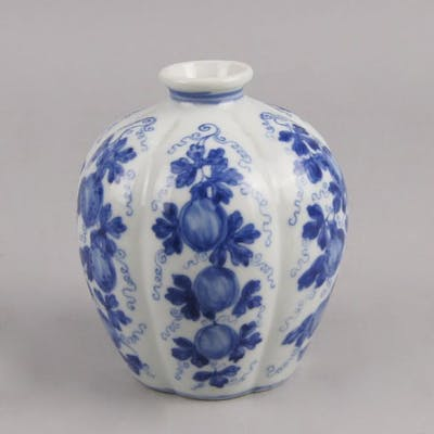 A Chinese blue and white vase, of recent manufacture, of oval form