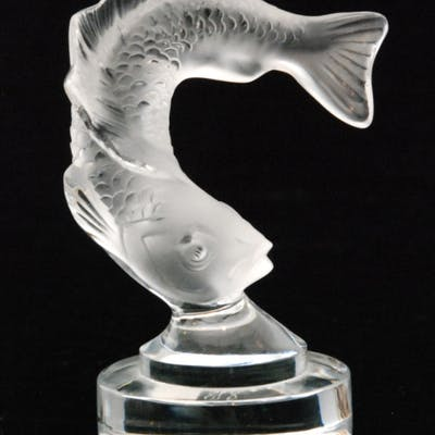 A Lalique Leaping Fish figure with a frosted finish...