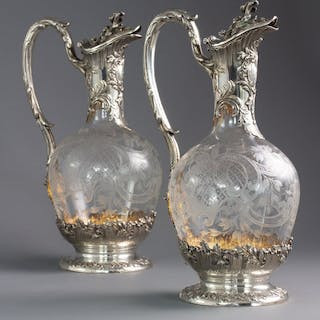A Pair of Late 19th Century French Silver and Crystal Claret Jugs
