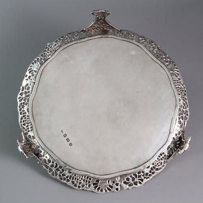 An early George III shaped circular salver with a cast gallery, Walter