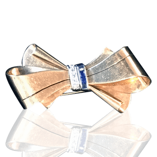 [unattributed] 14 kt gold jewelry : Retro bow pin with sapphires &