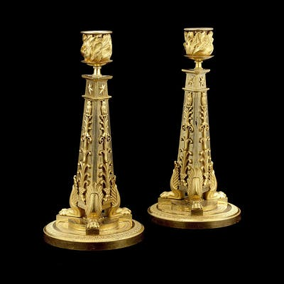 A pair of early 19th century French Empire gilt bronze candlesticks