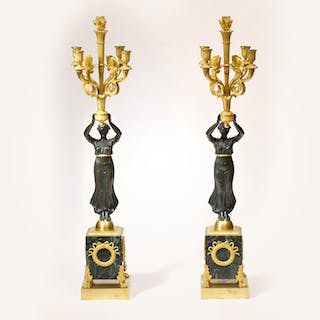 A pair of candelabra with significant representation of Victoria