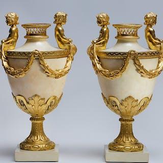 A pair of Louis XVI ormolu mounted marble vases