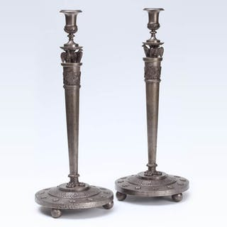 A pair of large german neoclassical iron large candlesticks