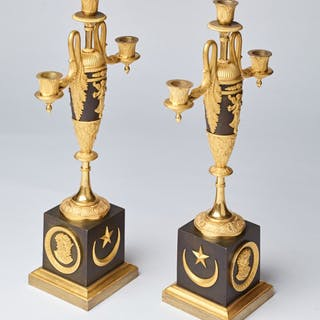 A pair of Charles X bronze and gilt bronze three light candelabra
