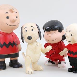 Group of (4) Peanuts' figurines. FR3SH