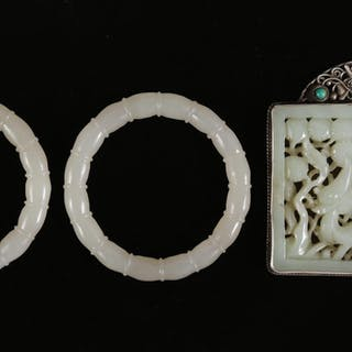 Chinese Carved Jade Plaque Mounted as a Pendant and a Pair of Jade
