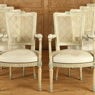 A set of eight painted French Louis XVI style dining...