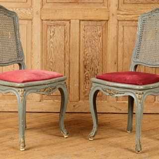 A pair of painted Louis XV-style cane back side chairs