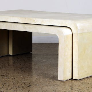 A set of three nesting coffee tables in the manner of...