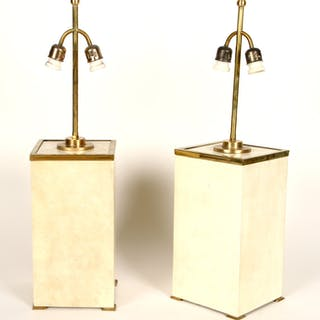 A pair of parchment and brass two light table lamps in...