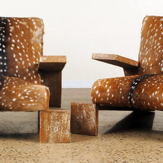 A pair of cerused oak lounge chairs upholstered in deer...