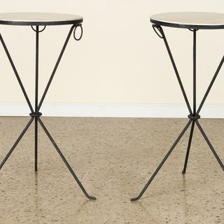 A pair of round parchment top cocktail tables on iron...
