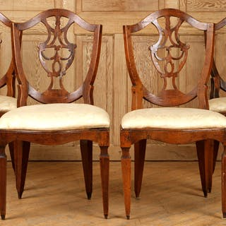 A set of four nineteenth century Hepplewhite-style chairs...