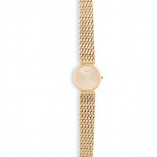 A LADY'S 18K GOLD MANUAL WIND BRACELET WATCH