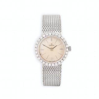 A LADY'S 18K GOLD AND DIAMOND-SET COCKTAIL WATCH