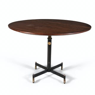 A circular teak table by Gio Ponti produced by Radice