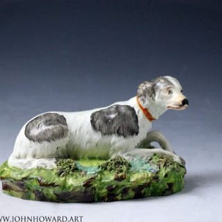 Staffordshire pearlware pottery setter dog on green rocky base Enoch