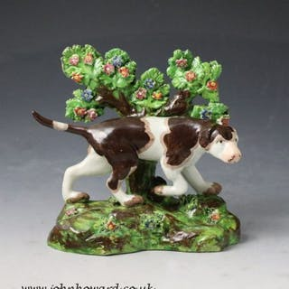 Staffordshire pottery bocage figure of a pointer dog standing on a