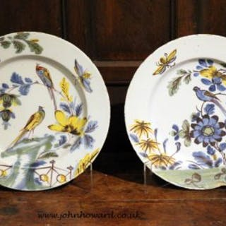 Pair of English Delftware polychrome decorated chargers of exceptional